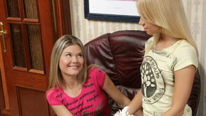 Ivanka and Karin - Gorgeous blonde teens Ivanka in red top and Karin kiss and caress passionately in the living room, then strip off their clothes. They lick each other's firm tits, then Ivanka fingers and licks Karin's shaved pussy in an armcha