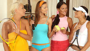 Deny, Devin, Iris and Juliette - Luscious, athletic teens Deny, brunette wearing pink, Devin, other brunette, Iris, blonde, and Juliette, multi colored hair, come into the living room after a game of tennis with their rackets, and start to kiss and caress