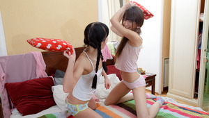 Ingrid and Lucy are cute, skinny lesbian teens with the urge to play. They're in bed and they look great as they get each other naked and share a few tender kisses. Their energy is for penetration and after a bit of foreplay that includes nipple sucking a