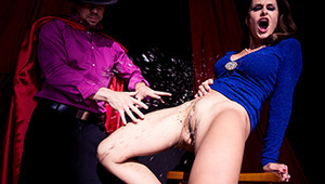 Everyone said it couldn't be done, but David Cockerfield's pulled it off again! Nora Noir's at a magic show watching the world's most famous magician perform impossible gimmicks. He's promised he can make any female volunteer squirt on-stage, in front of