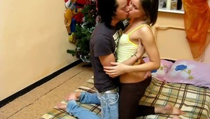 This couple just started living together and they do not have much furniture still. They celebrated that New Year in an empty room just with a bed and a New Years tree. But they did not give up and enjoyed the holiday to the full. They simply pleased each