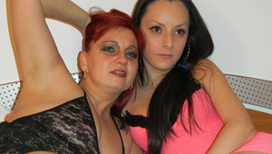 Horny mature slut doing her young lesbian lover