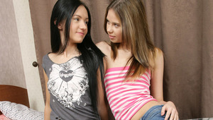 Bethany and Sasha - Adorable, petite teens Bethany, lighter hair, and raven haired Sasha kiss and embrace passionately in bed, then Sasha helps Bethany off with her clothes and goes down on her. She fingers and licks Bethany's tight pussy, then takes