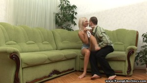 This blonde libertine doesn't even need a bed to give her boyfriend a fucking he'll never forget. A large green corner sofa will do just fine when she gets face-fucked and follows with taking cock balls deep in her tight young pussy. She wants more and mo