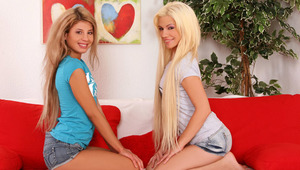 Anya and Dalia - Slender teen hotties Anya in blue top and Dalia in gray top, kiss tenderly in the living room, then they take off their tee shirts to suck and fondle one anothers' small tits and erect nipples. Dalia slides off Anya's skimpy, de